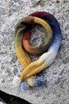Breipatroon Sjaal met pompons van andere kant